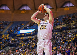 Dec 14, 2019; Morgantown, WV, USA; West Virginia Mountaineers guard Sean McNeil (22) shoots a three pointer from the corner during the second half against the Nicholls State Colonels at WVU Coliseum. Mandatory Credit: Ben Queen-USA TODAY Sports