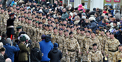 © under license to London News Pictures. 08/12/2010. 12 Logistic Support Regiment The Royal Logistic Corp (12 LSR), based in Abingdon, Oxon and Gutersloh, Germany, march through the centre of Abingdon after being awarded with their Afghanistan Campaign Medals. Members of the public and the soildiers families turned out in the cold weather to cheer the men and women on. Photo credit should read: Stephen Simpson/LNP