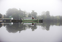 September 14, 2016 - Pooley Bridge, Cumbria, UK - Pooley Bridge UK. Picture shows the Ullswater Steamer sitting on the still water of Ullswater Lake in the morning mist at Pooley Bridge this morning. After last nights thunderstorms in the north of England Cumbria woke to a calm but misty morning. (Credit Image: © Andrew Mccaren/London News Pictures via ZUMA Wire)