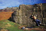 Joe Bawden bouldering on the Trackside boulder, Curbar