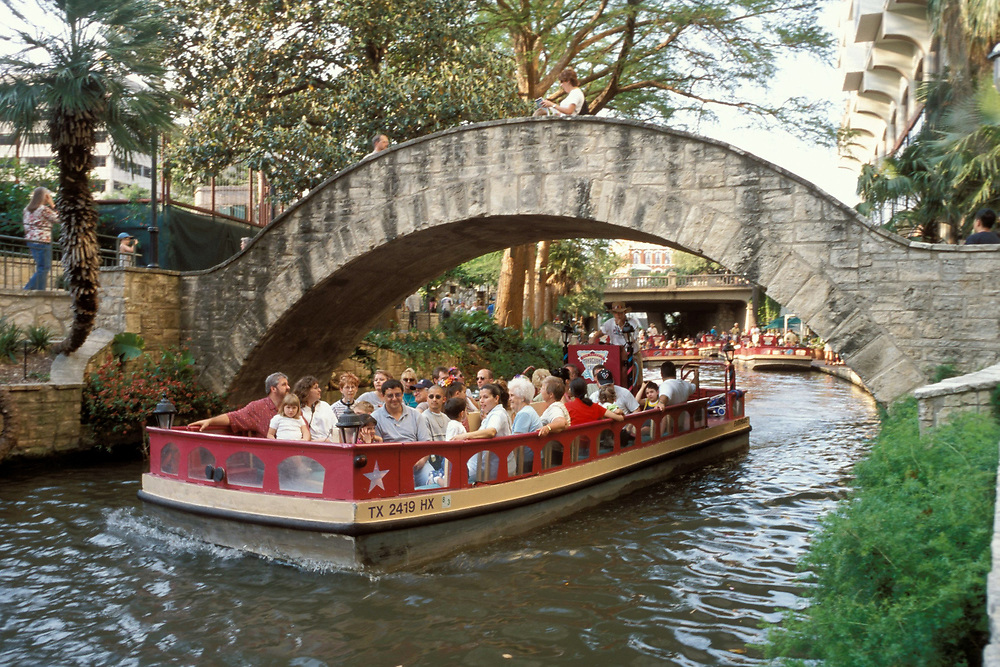 Multicultural tourists sightsee while on river barge on the Riverwalk in San Antonio, Texas.<br /> ©Bob Daemmrich