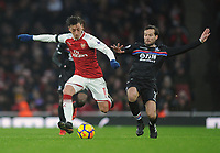 Football - 2017 / 2018 Premier League - Arsenal vs. Crystal Palace<br /> <br /> Mesut Ozil of Arsenal and Yohan Cabaye of Palace, at The Emirates.<br /> <br /> COLORSPORT/ANDREW COWIE