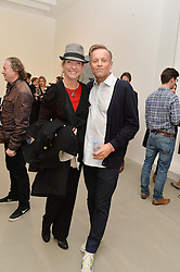 JORI WHITE and PETER J AMDAM at a private view of Refraction. The Image of Sense held at Blain Southern, Hanover Square, London on 9th December 2014.