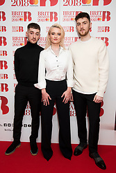 EDITORIAL USE ONLY XXXX (Left -Right) Luke Patterson, Grace Chatto, and Jack Patterson of Clean Bandit attending the Brit Awards 2018 Nominations event held at ITV Studios on Southbank, London. Photo credit should read: David Jensen/EMPICS Entertainment