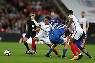 Dele Alli of England breaks away from Marek Hamsik of Slovakia (17). FIFA World cup qualifying match, European group F, England v Slovakia at Wembley Stadium in London on Monday 4th September 2017.<br /> pic by Andrew Orchard, Andrew Orchard sports photography.