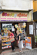 Tourists outside small local shop in the historic town of Galle, Sri Lanka, Asia