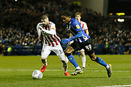 Sheffield Wednesday midfielder Rolando Aarons (39) goes past Sheffield United defender Kieron Freeman (18)  during the EFL Sky Bet Championship match between Sheffield Wednesday and Sheffield United at Hillsborough, Sheffield, England on 4 March 2019.