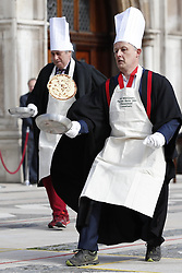 © Licensed to London News Pictures. 05/03/2019. London, UK. People wear fancy dress as they take part in an inter-Livery Company pancake race in Guildhall Yard in The City of London. Participants from the Poulters, the Fruiterers, the Cutlers, Mansion House, Guildhall and Old Bailey are raising money for The Lord Mayor's Charity. Photo credit: Peter Macdiarmid/LNP