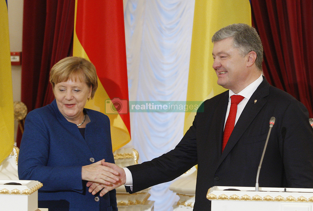 November 1, 2018 - Kiev, Ukraine - German Chancellor Angela Merkel (L) and Ukrainian President Petro Poroshenko (R) shake hands after a joint press-conference, following their meeting in Kiev, Ukraine, 1 November, 2018. Angela Merkel is on a visit to Ukraine at the invitation of Ukrainian President, for discuss about the situation in the Donbass and the Crimea, issues of strengthening trade and economic and investment cooperation between Ukraine and Germany, as well as discussing of European and Euro-Atlantic integration of Ukraine. (Credit Image: © Str/NurPhoto via ZUMA Press)