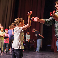 051414       Cable Hoover<br /> <br /> Colin Moore, right, and Seven Nation act out a scene during an improv class at El Morro Theatre Wednesday.