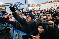 CESENATICO, ITALY - 5 JANUARY 2020: Supporters of Matteo Salvini, former Interior Minister of Italy and leader of the far-right League party, watch him during his rally in Cesenatico, Italy, on January 5th 2020.<br /> <br /> Matteo Salvini is campaigning in the region of Emilia Romagna to support the League candidate Lucia Borgonzoni running for governor.<br /> <br /> After being ousted from government in September 2019, Matteo Salvini has made it a priority to campaign in all the Italian regions undergoing regional elections to demonstrate that, in power or not, he still commands considerable support.<br /> <br /> The January 26th regional elections in Emilia Romagna, traditionally the home of the Italian left, has been targeted by Matteo Salvini as a catalyst for bringing down the government. A loss for the center-left Democratic Party (PD) against Mr Salvini's right would strip the centre-left party of control of its symbolic heartland, and probably trigger a crisis in its coalition with the Five Star Movement.