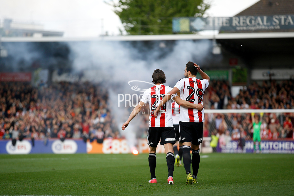 Brentford fans let of a flare as Brentford FC celebrate the opener (1-0) during the EFL Sky Bet Championship match between Brentford and Queens Park Rangers at Griffin Park, London, England on 22 April 2017. Photo by Andy Walter.