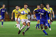 Brighton and Hove Albion defender Antef Tsoungui (71) battles with AFC Wimbledon attacker Zach Robinson (14) during the EFL Trophy Southern Group G match between AFC Wimbledon and Brighton and Hove Albion U21 at The People's Pension Stadium, Crawley, England on 22 September 2020.