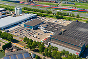 Nederland, Utrecht, Utrecht, 13-05-2019; Bedrijventerrein Lage Weide met Hema distributiecentrum aan de Atoomweg. In de achtergrond rijksweg A2 met The Wall.<br /> Lage Weide industrial estate with HEMA distribution center. <br /> luchtfoto (toeslag op standard tarieven);<br /> aerial photo (additional fee required);<br /> copyright foto/photo Siebe Swart