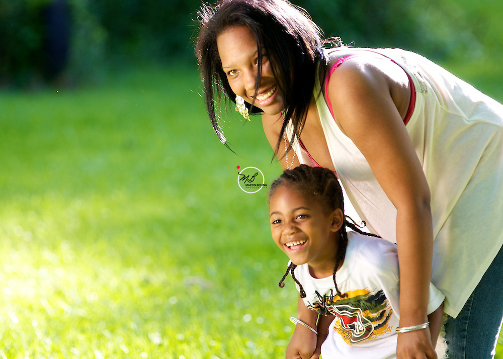 Mother and Son posing outdoors
