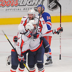 May 12, 2012: Washington Capitals defenseman Roman Hamrlik (44) is leaped on by left wing Troy Brouwer (20) in celebration of Hamrlik's goal during third period action in game 7 of the NHL Eastern Conference Semi-finals between the Washington Capitals and New York Rangers at Madison Square Garden in New York, N.Y. The Rangers defeated the Capitals 2-1.