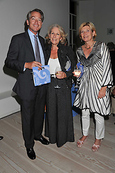 Left to right, AARNOUT SNOUCK HURGRONJE, VICTORIA AGNEW and SERENA LAMBERT at a fundraising party hosted by the Kensington and Chelsea Foundation at The Saatchi Gallery, Kings Road, London on 27th September 2011.