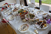 A table of food leftovers, the remains of Christmas excess on Christmas Day, on 25th December 2019, in Bristol, England.