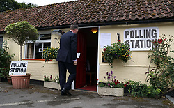 A person enters the polling station at the Golden Pheasant Public House in Lower Farringdon, Hampshire, to cast their vote in the 2017 General Election.