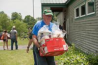 Brent Beck helps with the complimentary BBQ following the 70th Anniversary celebration of the Kiwanis Pool in St. Johnsbury Vermont.  Karen Bobotas / for Kiwanis International