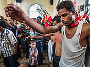 24 OCTOBER 2015 - YANGON, MYANMAR: Shia pray and pound their chests during Ashura observances at Mogul Mosque in Yangon. Ashura commemorates the death of Hussein ibn Ali, the grandson of the Prophet Muhammed, in the 7th century. Hussein ibn Ali is considered by Shia Muslims to be the third imam and the rightful successor of Muhammed. He was killed at the Battle of Karbala in 610 CE on the 10th day of Muharram, the first month of the Islamic calendar. According to Myanmar government statistics, only about 4% of the population is Muslim. Many Muslims have fled Myanmar in recent years because of violence directed against Burmese Muslims by Buddhist nationalists.    PHOTO BY JACK KURTZ