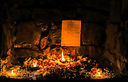 """17th December 2015, New Delhi, India. A photocopied wish with oil lamps and candles at a shrine dedicated to Djinns in the ruins of Feroz Shah Kotla in New Delhi, India on the 17th December 2015<br /> <br /> PHOTOGRAPH BY AND COPYRIGHT OF SIMON DE TREY-WHITE a photographer in delhi<br /> + 91 98103 99809. Email: simon@simondetreywhite.com<br /> <br /> People have been coming to Firoz Shah Kotla to pray to and leave written notes and offerings for Djinns in the hopes of getting wishes granted since the late 1970's. Jinn, jann or djinn are supernatural creatures in Islamic mythology as well as pre-Islamic Arabian mythology. They are mentioned frequently in the Quran  and other Islamic texts and inhabit an unseen world called Djinnestan. In Islamic theology jinn are said to be creatures with free will, made from smokeless fire by Allah as humans were made of clay, among other things. According to the Quran, jinn have free will, and Ibl?s abused this freedom in front of Allah by refusing to bow to Adam when Allah ordered angels and jinn to do so. For disobeying Allah, Ibl?s was expelled from Paradise and called """"Shay??n"""" (Satan).They are usually invisible to humans, but humans do appear clearly to jinn, as they can possess them. Like humans, jinn will also be judged on the Day of Judgment and will be sent to Paradise or Hell according to their deeds. Feroz Shah Tughlaq (r. 1351–88), the Sultan of Delhi, established the fortified city of Ferozabad in 1354, as the new capital of the Delhi Sultanate, and included in it the site of the present Feroz Shah Kotla. Kotla literally means fortress or citadel."""