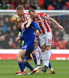 Everton's Tom Davies (left) and Stoke City's Ryan Shawcross (centre) and Stoke City's Charlie Adam battle for the ball during the Premier League match at the bet365 Stadium, Stoke.