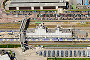Nederland, Gelderland, Geldermalsen, 26-06-2014. trein staat stil in station Geldermalsen. Met parkeerterrein en fietsenstalling.<br /> luchtfoto (toeslag op standard tarieven);<br /> aerial photo (additional fee required);<br /> copyright foto/photo Siebe Swart
