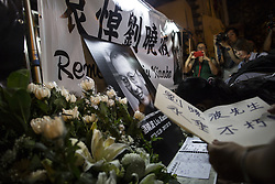July 13, 2017 - Hong Kong, Hong Kong - People mourn the death of Chinese Nobel Peace Prize winner Liu Xiaobo outside the Chinese Liaison Office in Sai Wan, Hong Kong. Liu Xiaobo died of cancer in hospital one month after being transferred from prison. (Credit Image: © Chan Long Hei/Pacific Press via ZUMA Wire)
