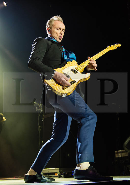 © Licensed to London News Pictures. 17/03/2015. London, UK.   Spandau Ballet performing live at The O2 Arena.   In this picture - Gary Kemp. Spandau Ballet are a British new wave band formed in London in the late 1970s, composed of members Tony Hadley (lead vocals, synthesisers), Gary Kemp ( guitar, keyboards, backing vocals), Steve Norman (saxophone, guitar, percussion), John Keeble –(drums, backing vocals), <br /> Martin Kemp (bass).  Photo credit : Richard Isaac/LNP