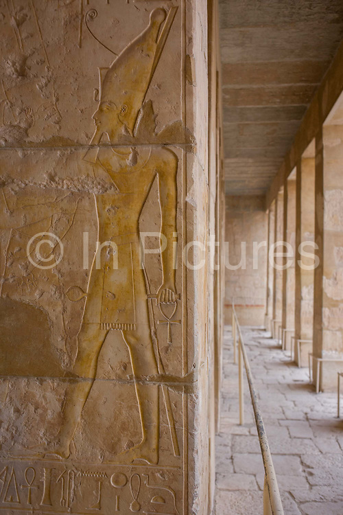 """Hieroglyphs on columns at the deserted ancient Egyptian Temple of Hatshepsut near the Valley of the Kings, Luxor, Nile Valley, Egypt. According to the country's Ministry of Tourism, European visitors to Egypt is down by up to 80% in 2016 from the suspension of flights after the downing of the Russian airliner in Oct 2015. Euro-tourism accounts for 27% of the total flow and in total, tourism accounts for 11.3% of Egypt's GDP. The Mortuary Temple of Queen Hatshepsut, the Djeser-Djeseru, is located beneath cliffs at Deir el Bahari (""""the Northern Monastery""""). The mortuary temple is dedicated to the sun god Amon-Ra and is considered one of the """"incomparable monuments of ancient Egypt."""" The temple was the site of the massacre of 62 people, mostly tourists, by Islamists on 17 November 1997."""