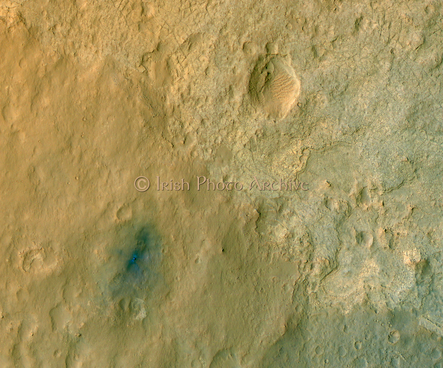 This color-enhanced view of NASA's Curiosity rover on the surface of Mars was taken by the HiRISE on NASA's Mars Reconnaissance Orbiter as the satellite flew overhead.