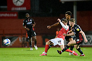 George Lloyd (19) of Cheltenham TownJacob Bedeau (4) of Scunthorpe United Mason O'Malley (38) of Scunthorpe United battles for possession during the EFL Sky Bet League 2 match between Cheltenham Town and Scunthorpe United at Jonny Rocks Stadium, Cheltenham, England on 20 October 2020.