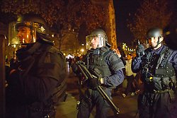 © Licensed to London News Pictures. 15/11/2015. Paris, France. French special forces secure Place de La Republique after a false attack alarm in Paris, France following the Paris terror attacks on Sunday, 15 November 2015. Photo credit: Tolga Akmen/LNP