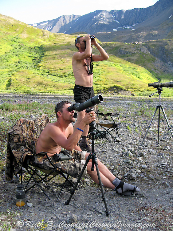Guides and hunters use spotting scopes to scout for Dall Sheep in the Chugach Mountains of Alaska