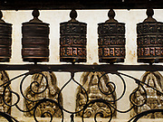 11 MARCH 2017 - KATHMANDU, NEPAL:  Buddhist prayer wheels (dharma wheels) at Swayambhu Stupa. The second most important Buddhist stupa in Kathmandu, Swayambhu Stupa is also a historic landmark and has panoramic views of Kathmandu. It is sacred to both Buddhists and Hindus. The stupa is being rebuilt because it was badly damaged in the 2015 earthquake.   PHOTO BY JACK KURTZ