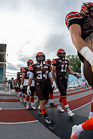 KELOWNA, BC - AUGUST 17:  Jonah Williams #34 and Adam Burton #11 of Okanagan Sun walk to the field against the Westshore Rebels  at the Apple Bowl on August 17, 2019 in Kelowna, Canada. (Photo by Marissa Baecker/Shoot the Breeze)