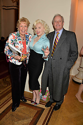 Left to right, CHRISTINE HAMILTON, Marilyn Monroe lookalike SUZY KENNEDY and NEIL HAMILTON at a party to celebrate the publication of  'I Used to be in Pictures' an untold story of Hollywood by Austin Mutti-Mewse and Howard Mutti-Mewse held at The Lansdowne Club, London on 6th March 2014.