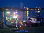 Party boats on the banks of the Mekong river in Phnom Penh, capital of Cambodia.