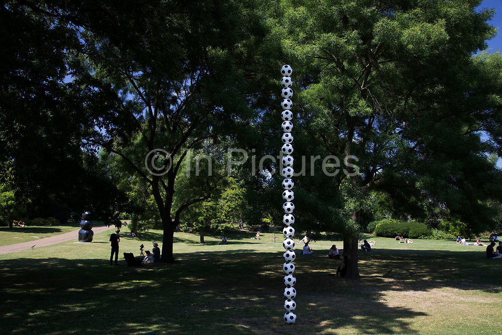 Frieze Sculpture 2017 opens to the public on July 5th 2017 in the English Gardens in Regents Park, London, England, United Kingdom. This is London's largest showcase of major outdoor works by leading artists and galleries, presenting a free outdoor exhibition for London and its international visitors throughout the summer months. Hank Willis Thomas, Endless Column 2017.