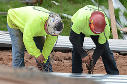 Steel Workers attaching a panel for elevation to the Roof during Steel Erection at the Central Connecticut State University New Academic Building Construction.
