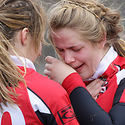 A Rutgers player is consoled by a team mate after the Rutgers V Hofstra, Women's University  Rugby match during the Four Leaf 15's Club Rugby Tournament at Randall's Island New York. The tournament included 70 teams in 6 divisions, organized by the New York City Village Lions RFC. Randall's Island, New York, USA. 23rd March. Photo Tim Clayton