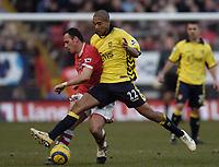 Photo: Olly Greenwood.<br />Charlton Athletic v Aston Villa. The Barclays Premiership. 25/02/2006.<br />Aston Villa's Jlloyd Samuel (R) and Charlton's Radostan Kishishev battle for the ball.