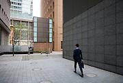 A salaryman walk in the street of Tokyo.