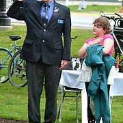 BRUNSWICK, Maine -- 5/30/16 -- Joe Donahue, American Legion Post 20 Commander and Retired U.S. Navy Senior Chief, of Brunswick, salutes with his granddaughter, Arianna Neuts, 8, of Freeport, during the National Anthem at the Memorial Day ceremony in Brunswick. The Memorial Day Parade and ceremonies in Brunswick and Topsham went off as planned following a few light showers in the early morning. Many of the other regional parades were cancelled due to expected bad weather. Photo by Roger S. Duncan for The Forecaster