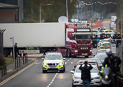 © Licensed to London News Pictures. 23/10/2019. Grays, UK. Police drive away the lorry from Waterglade Industrial Park in Grays, Essex where the bodies of 39 people have been found in a lorry container. The driver, a 25-year-old-man from Northern Ireland, has been arrested on suspicion of murder. . Photo credit: Peter Macdiarmid/LNP