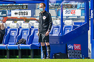 Fourth Official Sam Purkiss, face mask, during the EFL Sky Bet Championship match between Queens Park Rangers and Barnsley at the Kiyan Prince Foundation Stadium, London, England on 20 June 2020.