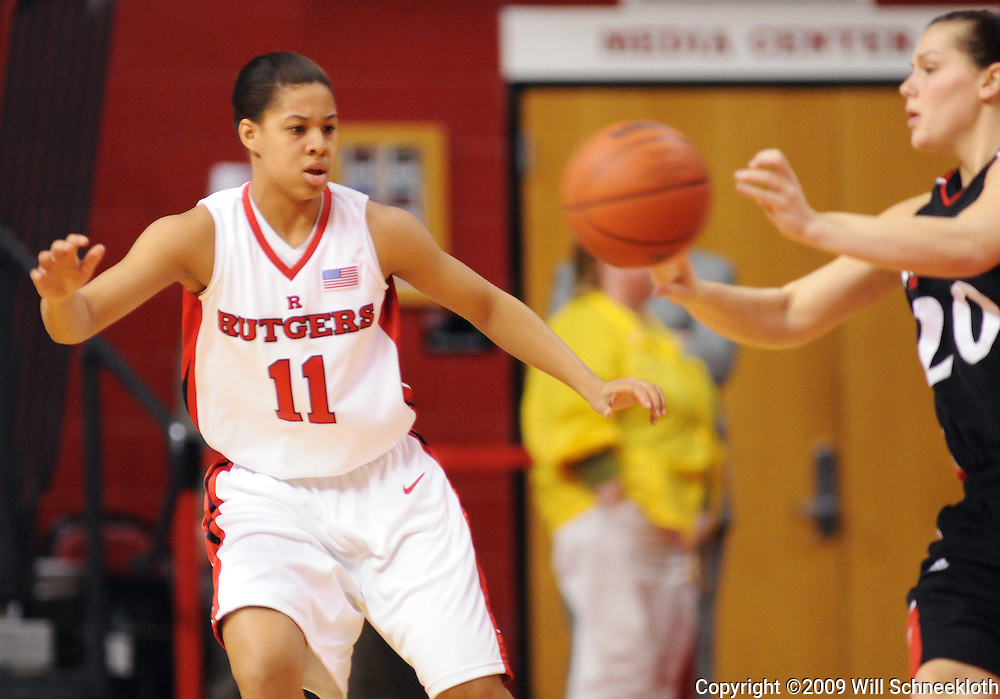 Feb 24, 2009; Piscataway, NJ, USA; Rutgers guard Nikki Speed (11) defends Cincinnati guard Kahla Roudebush (20) during the first half of Rutgers' 71-53 victory over Cincinnati at the Louis Brown Athletic Center.