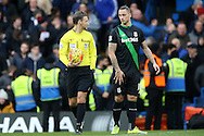 Referee Mark Clattenburg looks at Marko Arnautovic of Stoke City.Barclays Premier league match, Chelsea v Stoke city at Stamford Bridge in London on Saturday 5th March 2016.<br /> pic by John Patrick Fletcher, Andrew Orchard sports photography.
