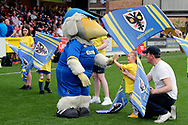 Haydon the Womble meeting AFC Wimbledon fan during the EFL Sky Bet League 1 match between AFC Wimbledon and Oldham Athletic at the Cherry Red Records Stadium, Kingston, England on 21 April 2018. Picture by Matthew Redman.